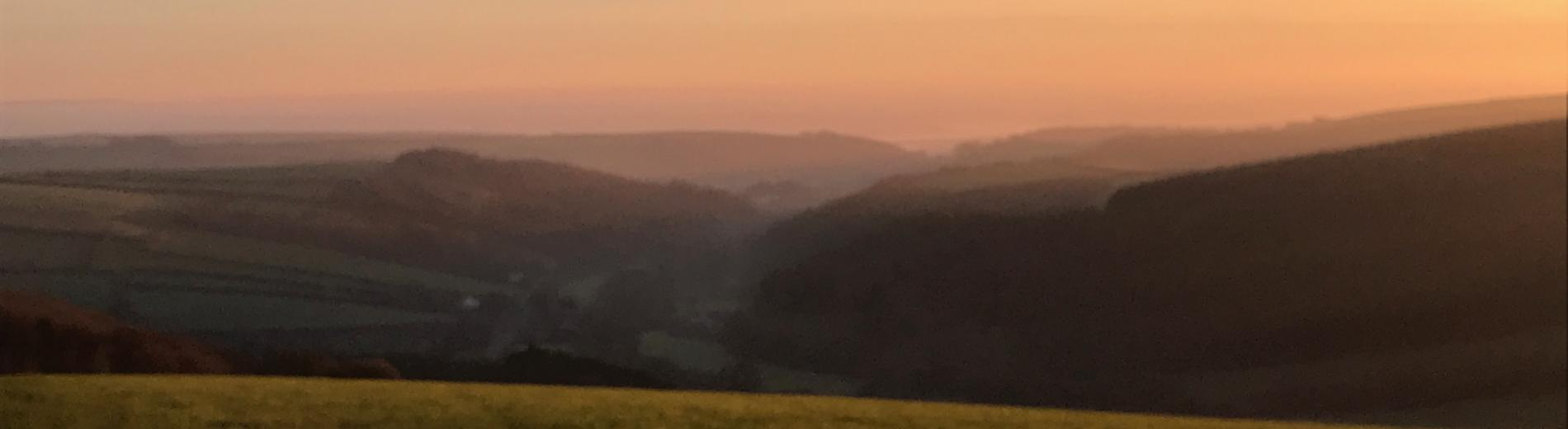 View looking over the hills of Spreacombe at sunset