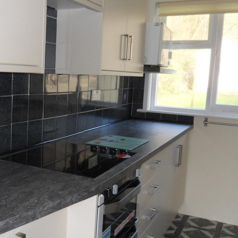 Kitchen for self catering cottage. Spreacombe gardens. Shows the new cooker and units
