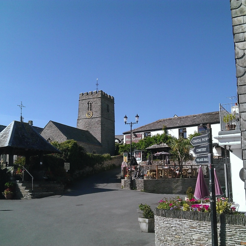 view of Mortehoe Church, village square and pub.