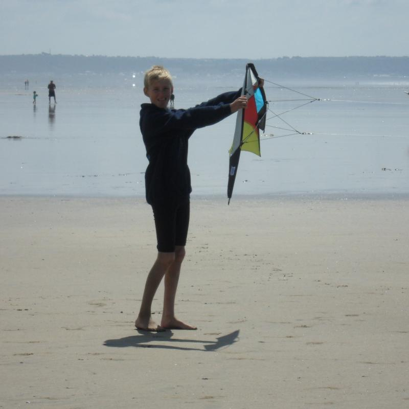 teenager flying a stunt kite