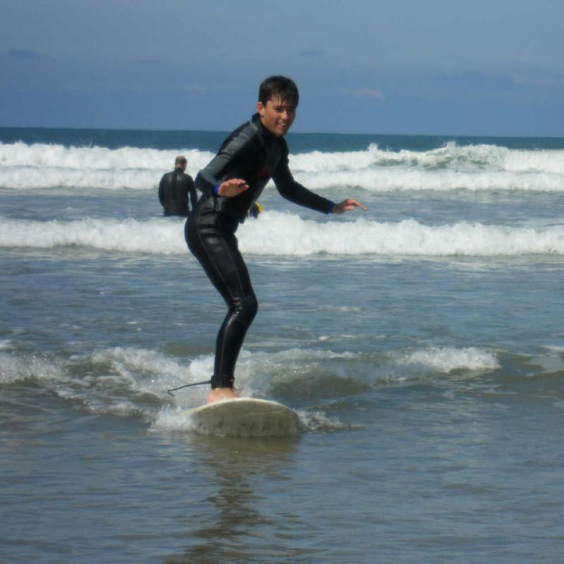 Teenager surfing at Saunton Beach