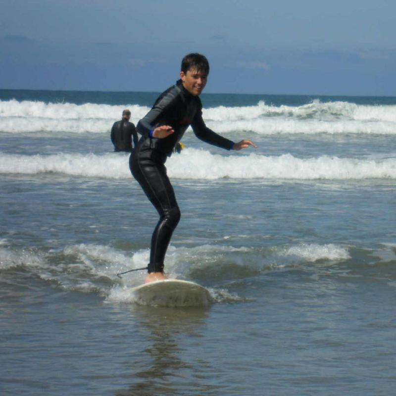 Boy having surfing lesson at Saunton