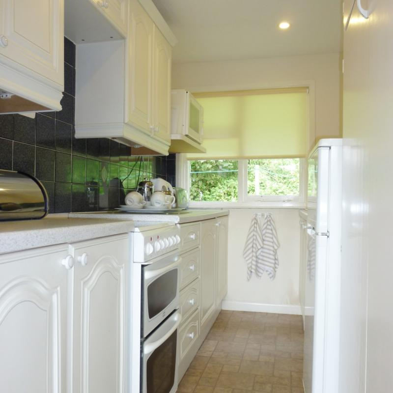 well equipped kitchen backing onto woodland