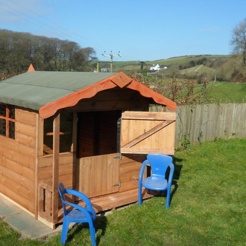 Small playhouse for children and view of the Spreacombe Valley